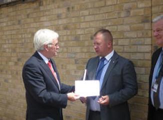 John McDonnell giving letter to EVRAZ