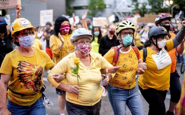 Moms July 20 Portland (Noah Berger:AP)