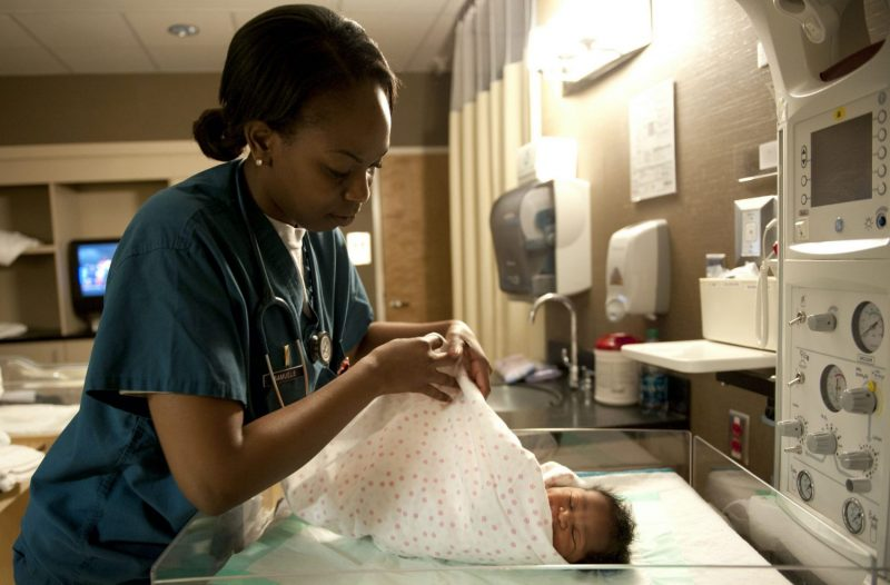 Black nurse and baby