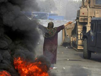 Supporters of the Muslim Brotherhood face a military attack in Cairo