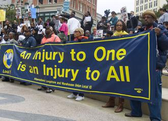 ILWU Local 10 members demonstrate at Oscar Grant Plaza in Oakland in 2010