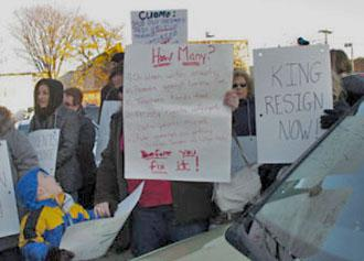 Parents protest outside a forum on Common Core standards in New York