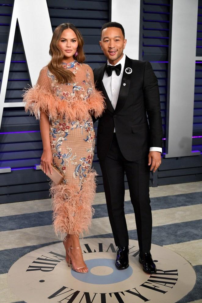 Chrissy Teigen and John Legend 2019 Vanity Fair Oscar Party Hosted By Radhika Jones - Arrivals