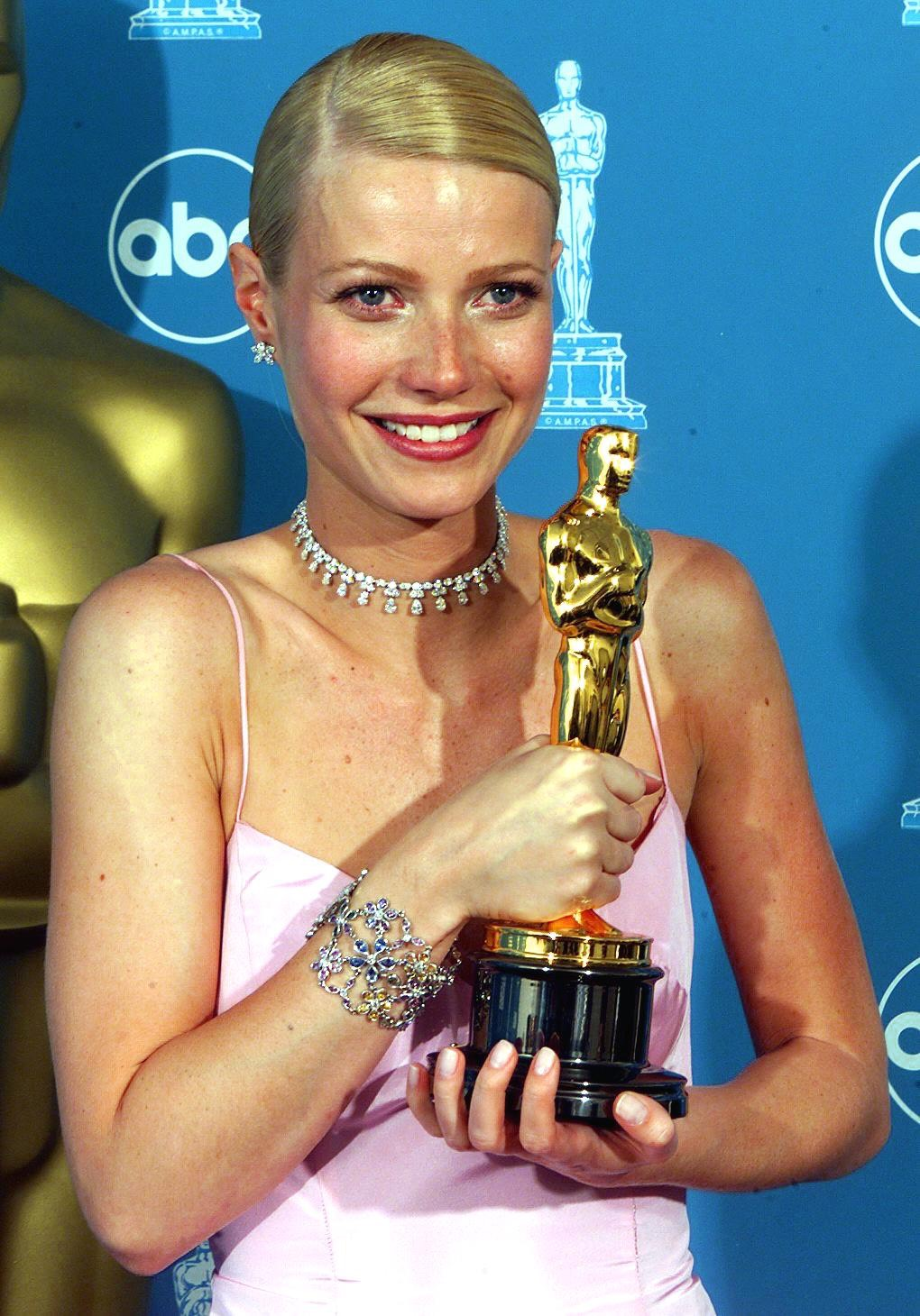 Actress Gwyneth Paltrow holds her Oscar for Best A