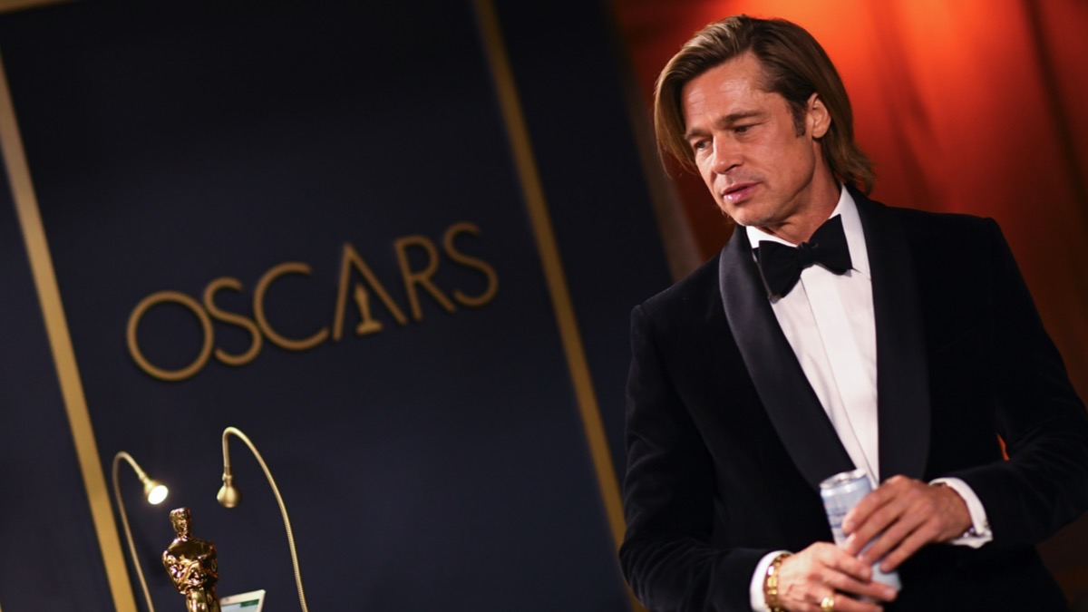 Brad Pitt waits for his award for Best Actor in a Supporting Role to be engraved