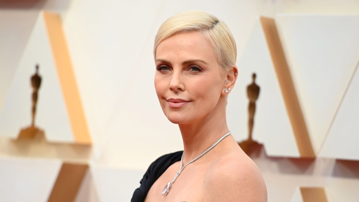 Charlize Theron arrives for the 92nd Oscars