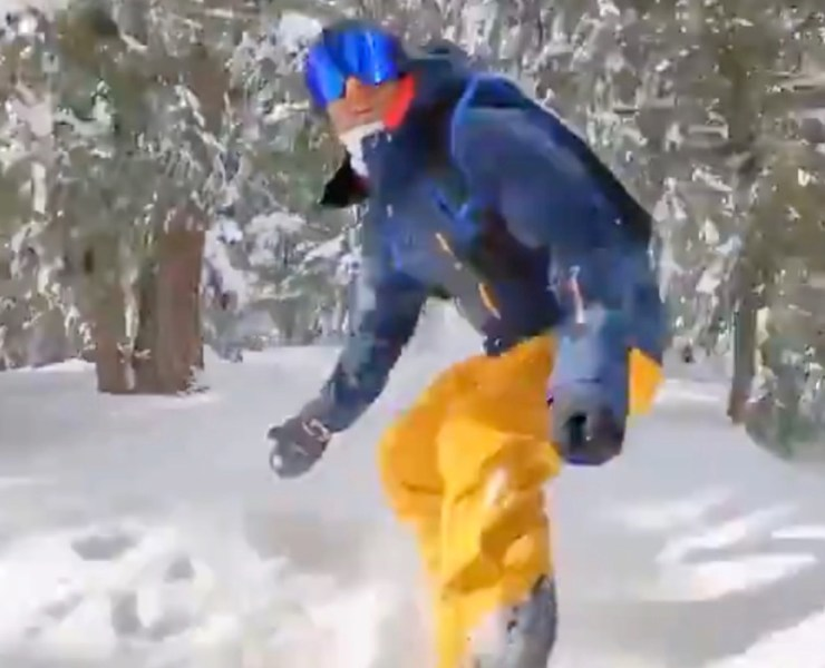 A snowboarder and a parachute
