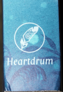 logo with a feather inside a circle and the word Heartdrum