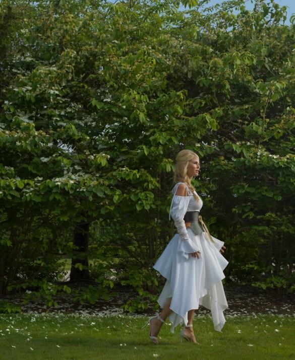 Dress by Loewe Belt by Loewe Shoes by Gianvito Rossi Earrings by Bonheur