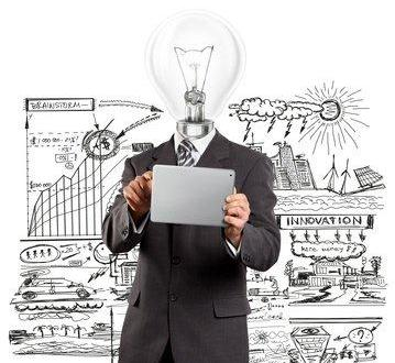 Lamp Head Businessman With Touch Pad and sketches in the backround- business model innovation