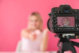 blonde-influencer-recording-make-up-video_23-2148135452