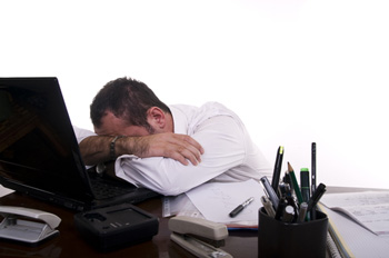 Stressed and frustrated businessman by Doruk on Shutterstock.com