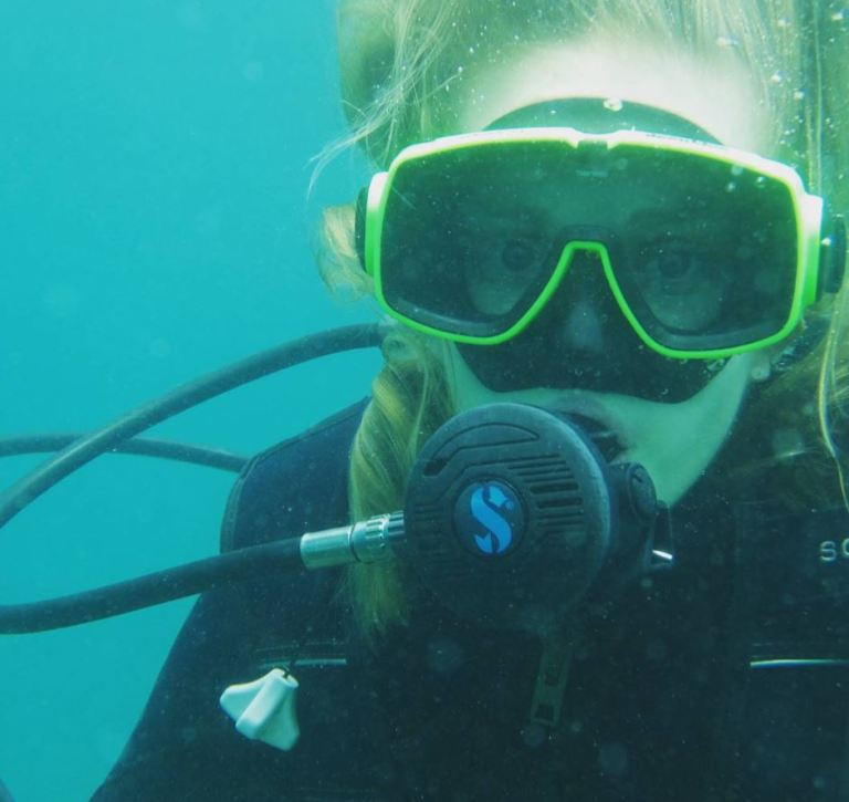 Melissa Hobson underwater wearing a snorkel and wet suit.