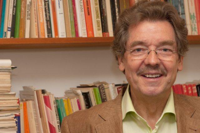 Willi Semmler, Arnhold Professor of International Cooperation and Development, sits in his office