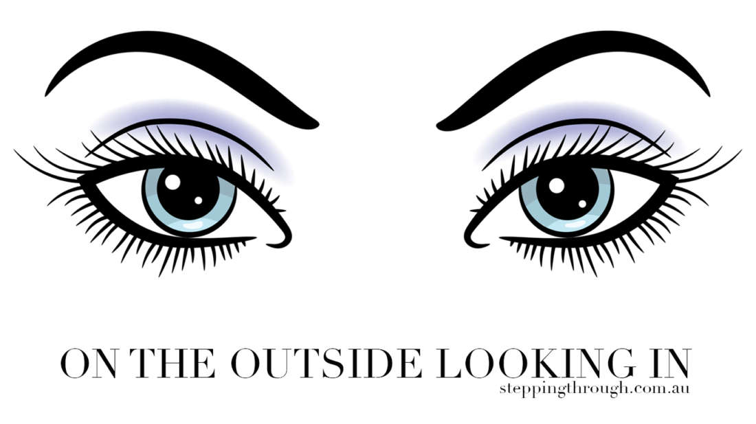 on the outside looking in, female eyes with dark eyelashes
