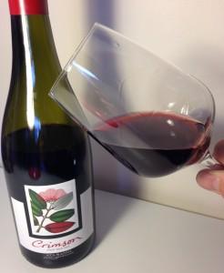 2013 Ata Rangi Crimson Pinot Noir and wine glass showing its beautiful color