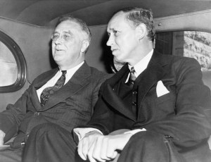 President Franklin D. Roosevelt and Harry Hopkins in the back seat of an automobile in Rochester, Minnesota, after visiting son James Roosevelt in hospital, 1938