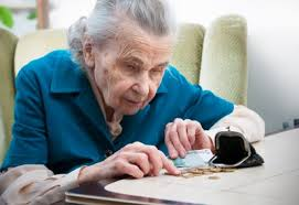 An elderly woman is shown counting Pennies