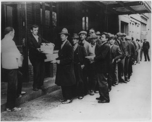 Depression: Breadlines:long line of people waiting to be fed: New York City: in the absence of substantial government relief programs during 1932, free food was distributed with private funds in some ; ca. 2/1932