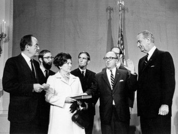 Wilbur Cohen being sworn in as Secretary of HEW. Looking on are President Johnson (r), Vice-President Hubert Humphrey and Cohen's wife and three sons