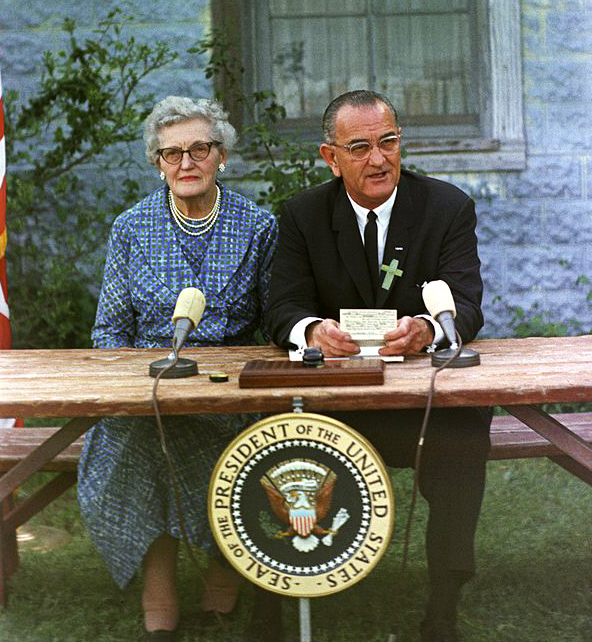 Lyndon B. Johnson at the ESEA signing ceremony, with his childhood schoolteacher Ms. Kate Deadrich Loney