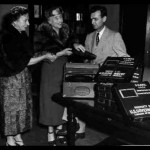 Helen Keller and M. Robert Barnett, executive director of AFB, examining records that go with a talking book machine for President Dwight D. Eisenhower at the Fitzsimons Army Hospital. Polly Thomson is at Miss Keller's side, circa 1955.