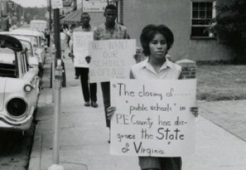 Sandy Stokes walks down Main Street in Farmville to protest school closures in July of 1963. Photo courtesy of VCU Libraries.