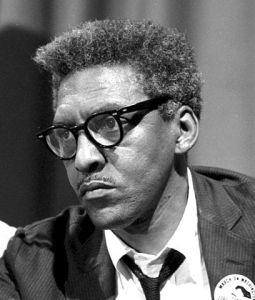 Bayard Rustin at news briefing on the Civil Rights March on Washington
