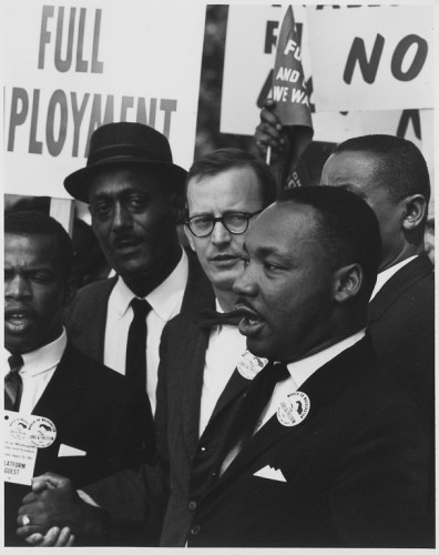 Dr. Martin Luther King, Jr., President of the Southern Christian Leadership Conference, and Mathew Ahmann, Executive Director of the National Catholic Conference for Interrracial Justice, in a crowd.
