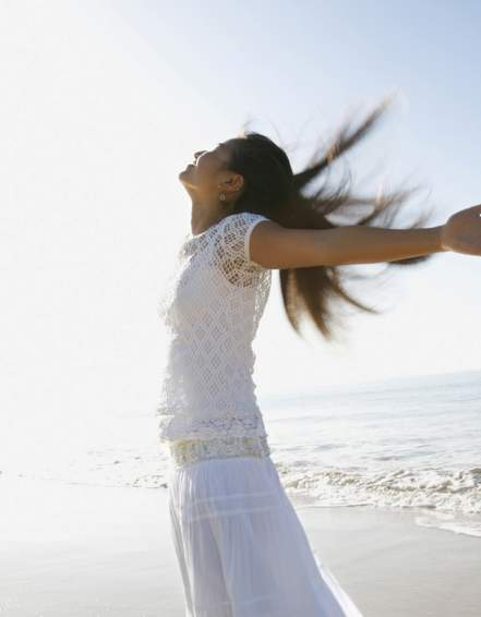 Woman in a breeze on the beach