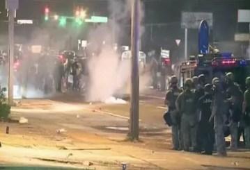 Police fire tear gas in Ferguson Missouri