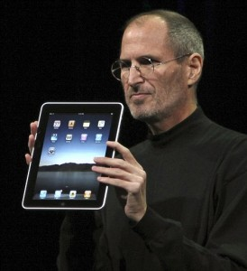 Steve Jobs holding up the iPad