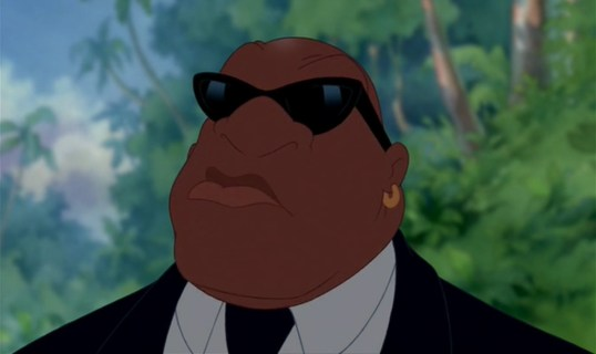 A picture of Cobra bubbles wearing a suit, tie, collared shirt, and sunglasses