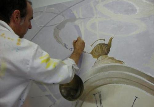 """O artista na pintura do quadro """"O Tempo"""""""