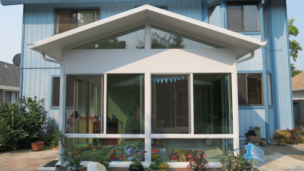 Exterior view of solid roof sunroom