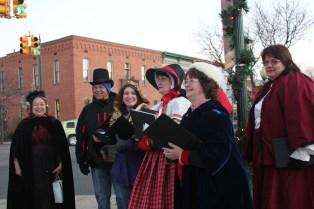 Choir members from the Vicksburg United Methodist Church Choir serenade Christmas visitors.