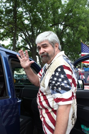 Village President Keith Gunnett waves.