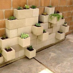 Garden wall out of concrete cinder blocks aka hollow masonry blocks