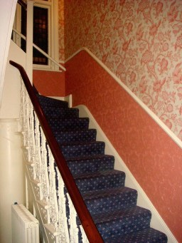 If you didn't know it was there you might just miss it. The stairs tucked behind the bar leading up to rooms 111 & 112