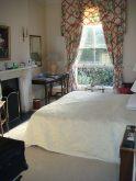 The bedroom in the suite.