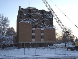 The upper floors of Q-Hall exposed as the wrecking ball goes to work
