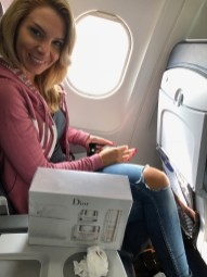 Daiana inspecting her loot on the flight