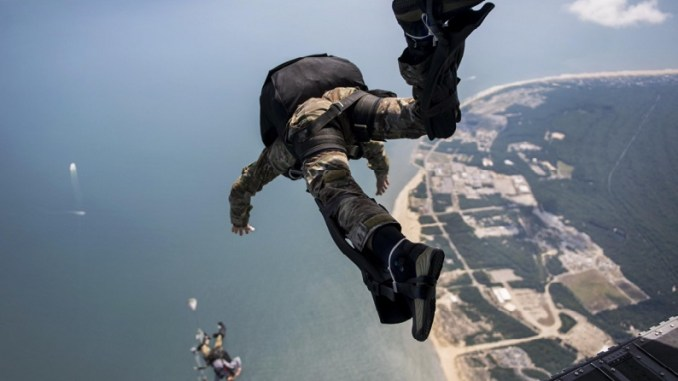 Sailors exit a Chinook during HALO parachute jump. (DoD photo July 20, 2017).