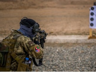 A member of a Female Tactical Platoon Afghanistan of the ASSF fires weapon on rifle range. Photo by SSG Douglas Ellis, NSOCC-A, March 13, 2018.