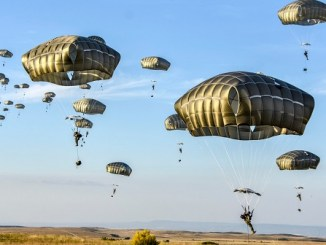American and Spanish paratroopers descend onto a drop zone near Zaragoza, Spain on June 23, 2018. Army photo by Lt. Col. John Hall.