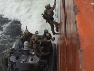 Trojan Footprint UW in Baltic States. U.S. and Danish maritime special operations forces board a ship in the Baltic Sea. Photo by SOCEUR, June 4, 2018.
