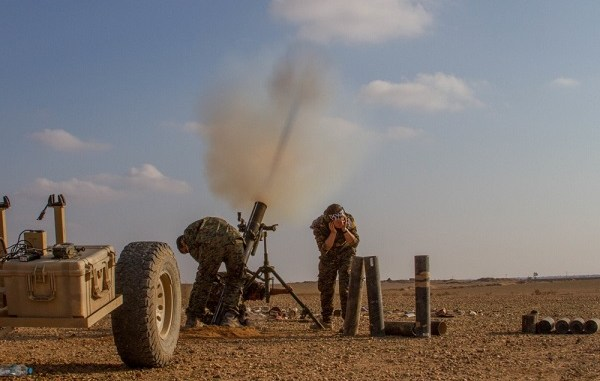 SDF mortar team fires 120mm at ISIS target near Deir ez-Zor in the Middle Euphrates River Valley, Syria. Photo by SGT Matthew Crane, CJTF-OIR, November 16, 2018.