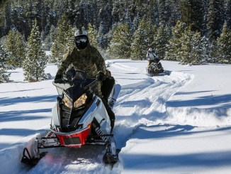 10th Special Forces Group Soldiers riding snowmobiles during training. 10th SFGA FB 20200127.