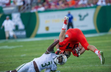 USF CB Deatrick Nichols upends Syracuse WR 2015 (1191x774)