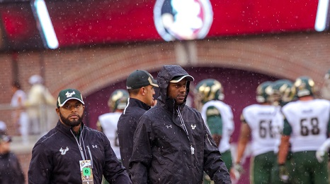 USF Head Coach Willie Taggart in rain gear at FSU 2015